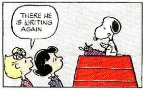 Snoopy There he is writing again