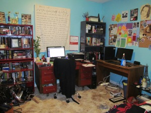 My red and wood desk, and my husband's desk. with bookcases...