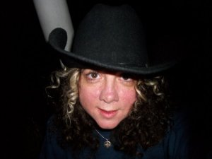 me with curls and hat